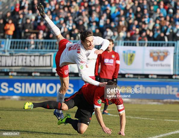 Jonathan Kotzke of Regensburg is challenged by Ronny Garbuschewski of Chemnitz during the 3rd Liga match between Chemnitz and Regensburg at Stadion...