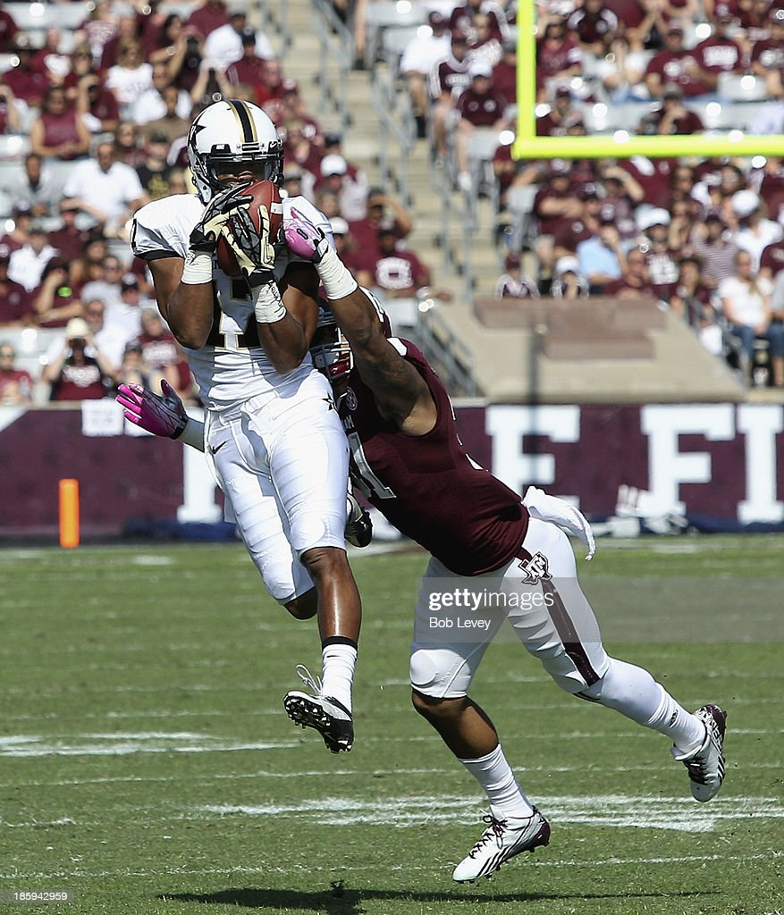 Jonathan Krause #17 of the Vanderbilt Commodores completes a pass in front of Howard Matthews #31 of the Texas A&M Aggies in the first quarter at Kyle Field on October 26, 2013 in College Station, Texas.