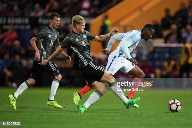 Jonathan Leko of England and Arne Maier of Germany compete for the ball during the U19 International match between England and Germany at One Call...