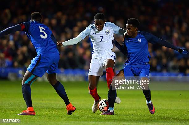 Jonathan Leko of England U21 in action with Myziane Maolida of France U18 during the U18 International Friendly match between England and France at...