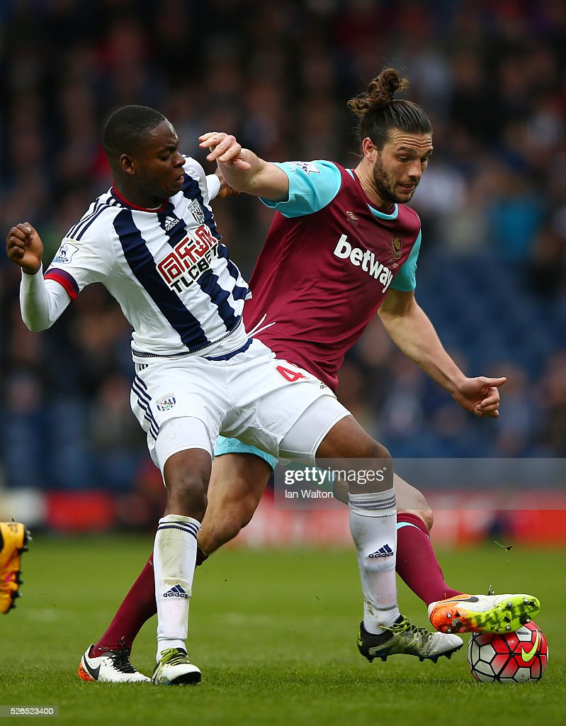 Jonathan Leko of West Bromwich Albion and Andy Carroll of West Ham United compete for the ball during the Barclays Premier League match between West Bromwich Albion and West Ham United at The Hawthorns on April 30, 2016 in West Bromwich, England.