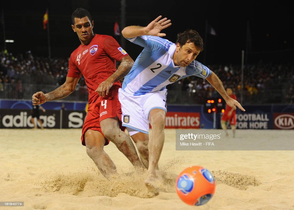 Jonathan Levi of Argentina is challenged by Heimanu Taiarui of Tahiti during the FIFA Beach Soccer World Cup Tahiti 2013 Quarter Final match between Argentina and Tahiti at the Tahua To'ata Stadium on September 25, 2013 in Papeete, French Polynesia.