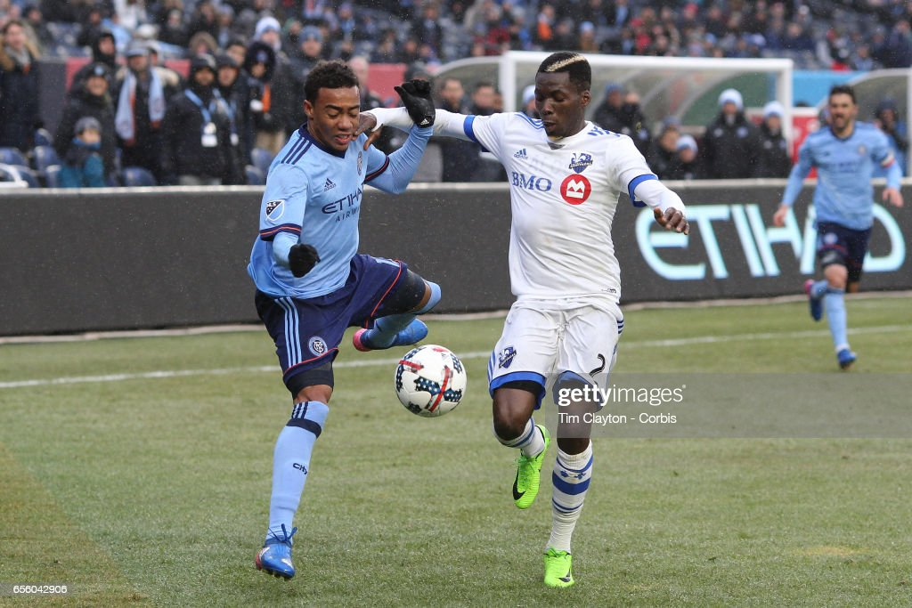 Jonathan Lewis #17 of New York City FC and Ambroise Oyongo #2 of Montreal Impact challenge for the ball during the New York City FC Vs Montreal Impact regular season MLS game at Yankee Stadium on March 18, 2017 in New York City.