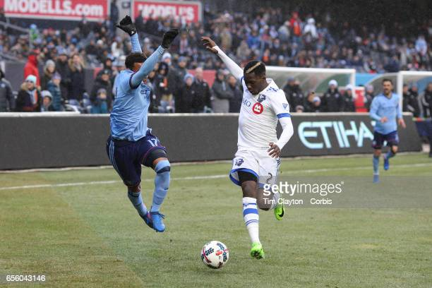 Jonathan Lewis of New York City FC and Ambroise Oyongo of Montreal Impact challenge for the ball during the New York City FC Vs Montreal Impact...