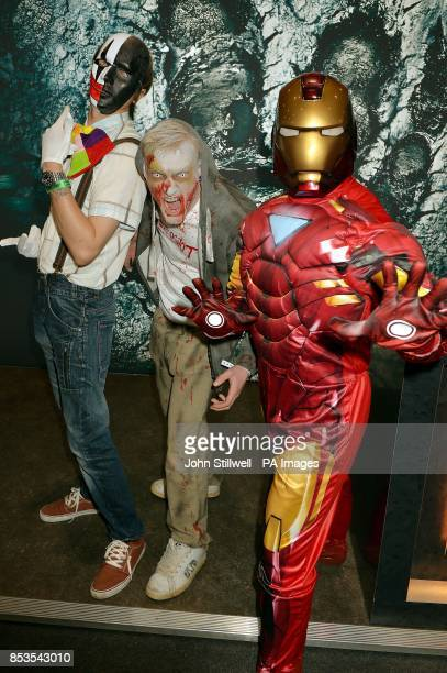 Jonathan Locke Scott Glover and Simon Fletcher wearing comic character outfits at the Comic Con exhibition which brings together fans of Comic book...