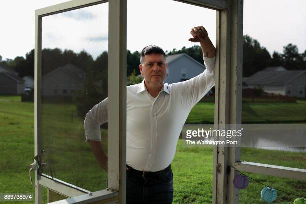 Jonathan Lubecky former Army and Marine Corps veteran who returned from Iraq War with severe PTSD outside his home in Summerville SC USA on August 24...