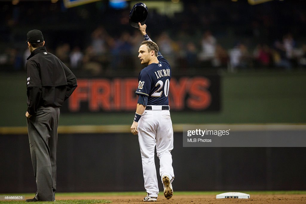 <a gi-track='captionPersonalityLinkClicked' href=/galleries/search?phrase=Jonathan+Lucroy&family=editorial&specificpeople=5732413 ng-click='$event.stopPropagation()'>Jonathan Lucroy</a> #20 of the Milwaukee Brewers acknowledges the crowd after breaking a Major League Baseball record by hitting his 46th double in a single season as a catcher during the game against the Chicago Cubs at Miller Park on Saturday, September 27, 2014 in Milwaukee, Wisconsin.