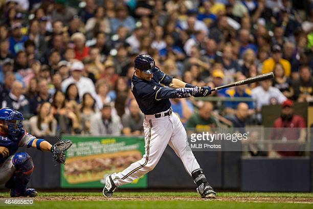 Jonathan Lucroy of the Milwaukee Brewers breaks a Major League Baseball record by hitting his 46th double in a single season as a catcher during the...