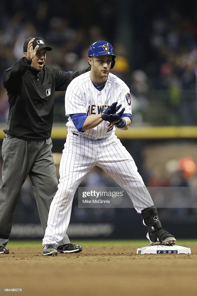<a gi-track='captionPersonalityLinkClicked' href=/galleries/search?phrase=Jonathan+Lucroy&family=editorial&specificpeople=5732413 ng-click='$event.stopPropagation()'>Jonathan Lucroy</a> #20 of the Milwaukee Brewers celebrates after hitting a double scoring Ryan Bruan in the bottom of the eighth inning against the Pittsburgh Pirates at Miller Park on April 12, 2014 in Milwaukee, Wisconsin.