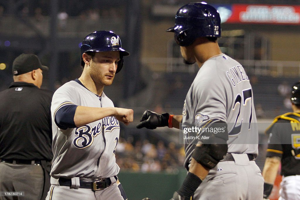 <a gi-track='captionPersonalityLinkClicked' href=/galleries/search?phrase=Jonathan+Lucroy&family=editorial&specificpeople=5732413 ng-click='$event.stopPropagation()'>Jonathan Lucroy</a> #20 of the Milwaukee Brewers celebrates after scoring in the fifth inning against the Pittsburgh Pirates during the game on August 27, 2013 at PNC Park in Pittsburgh, Pennsylvania.
