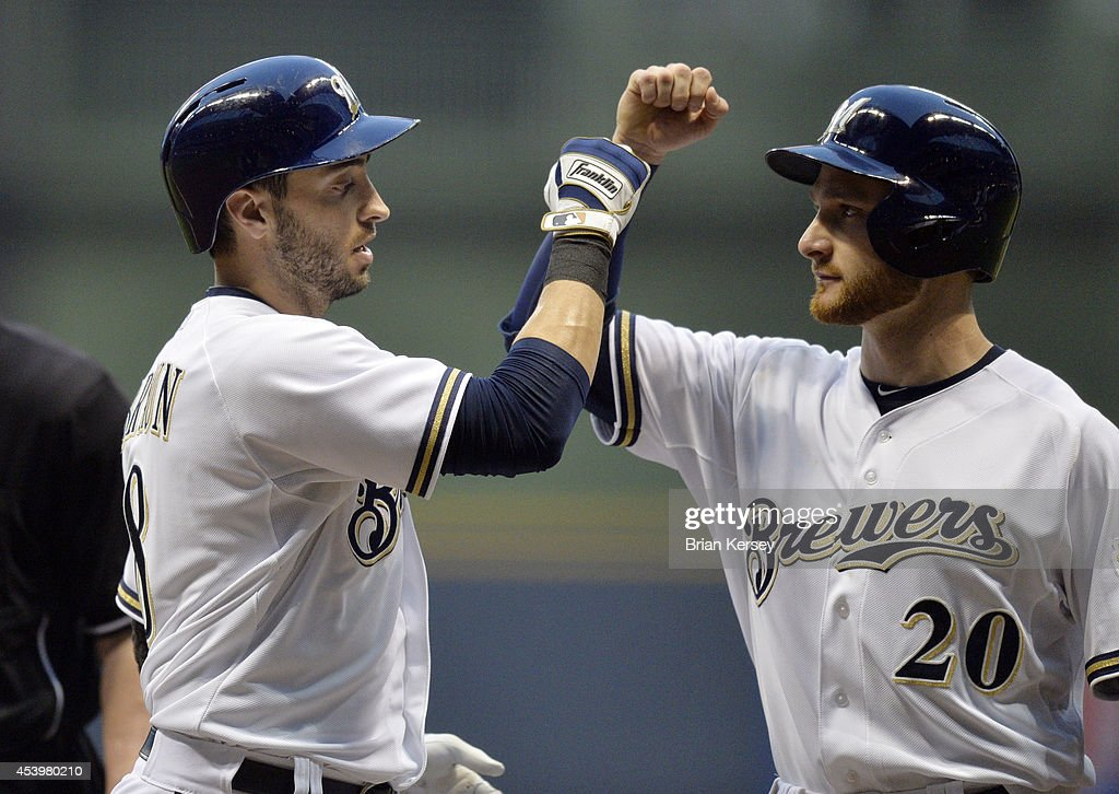 <a gi-track='captionPersonalityLinkClicked' href=/galleries/search?phrase=Jonathan+Lucroy&family=editorial&specificpeople=5732413 ng-click='$event.stopPropagation()'>Jonathan Lucroy</a> #20 of the Milwaukee Brewers (R) congratulates teammate Ryan Braun #8 at home plate after Braun hit a two-run home run scoring Lucroy during the first inning against the Pittsburgh Pirates at Miller Park on August 22, 2014 in Milwaukee, Wisconsin.