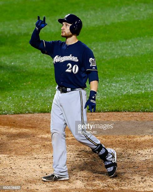 Jonathan Lucroy of the Milwaukee Brewers gestures after hitting a tworun home run in the 13th inning against the New York Mets on June 12 2014 at...