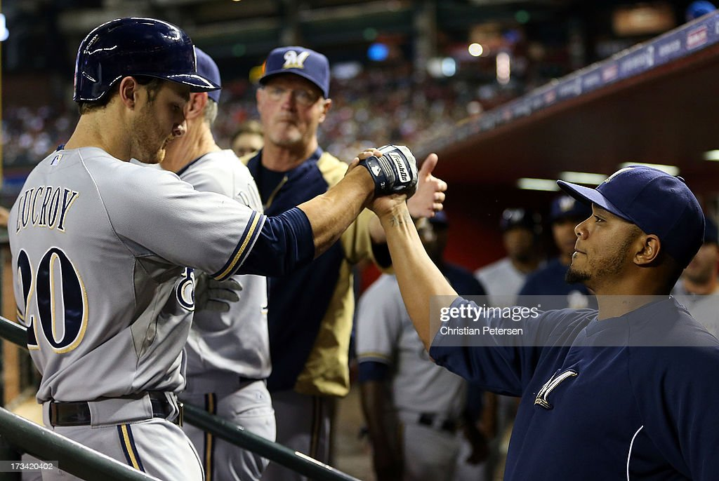 <a gi-track='captionPersonalityLinkClicked' href=/galleries/search?phrase=Jonathan+Lucroy&family=editorial&specificpeople=5732413 ng-click='$event.stopPropagation()'>Jonathan Lucroy</a> #20 of the Milwaukee Brewers high-fives Martin Maldonado #12 after hitting a two-run home run against the Arizona Diamondbacks during the sixth inning of the MLB game at Chase Field on July 13, 2013 in Phoenix, Arizona.