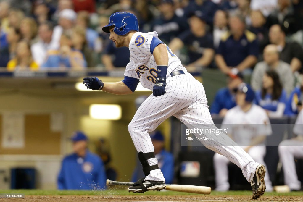 <a gi-track='captionPersonalityLinkClicked' href=/galleries/search?phrase=Jonathan+Lucroy&family=editorial&specificpeople=5732413 ng-click='$event.stopPropagation()'>Jonathan Lucroy</a> #20 of the Milwaukee Brewers hits a double scoring Ryan Bruan in the bottom of the eighth inning against the Pittsburgh Pirates at Miller Park on April 12, 2014 in Milwaukee, Wisconsin.