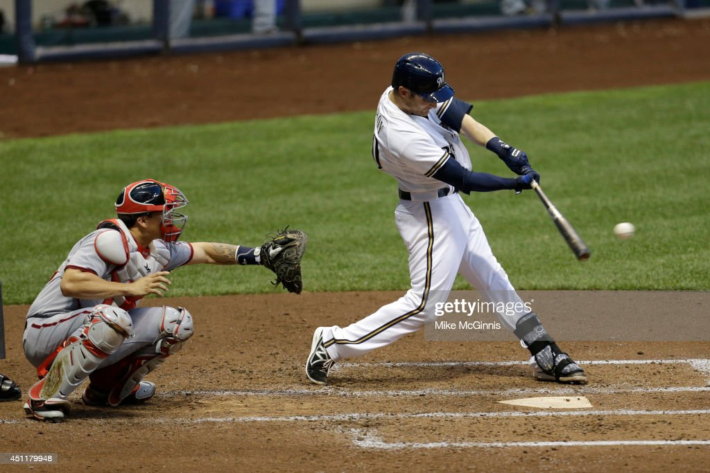 Jonathan Lucroy #20 of the Milwaukee Brewers hits a single in the bottom of the fourth inning against the Washington Nationals at Miller Park on June 24, 2014 in Milwaukee, Wisconsin.