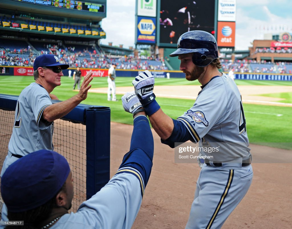 <a gi-track='captionPersonalityLinkClicked' href=/galleries/search?phrase=Jonathan+Lucroy&family=editorial&specificpeople=5732413 ng-click='$event.stopPropagation()'>Jonathan Lucroy</a> of the Milwaukee Brewers is congratulated by teammates after hitting a ninth inning home run against the Atlanta Braves at Turner Field on April 15, 2012 in Atlanta, Georgia. All uniformed team members are wearing jersey number 42 in honor of Jackie Robinson Day.