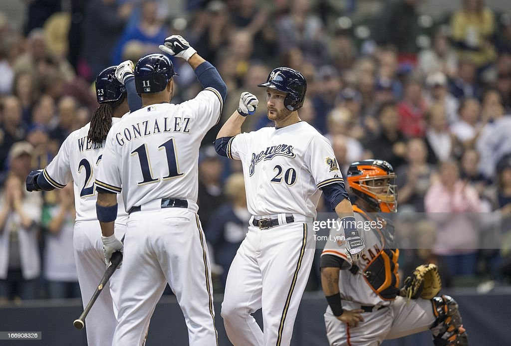 <a gi-track='captionPersonalityLinkClicked' href=/galleries/search?phrase=Jonathan+Lucroy&family=editorial&specificpeople=5732413 ng-click='$event.stopPropagation()'>Jonathan Lucroy</a> #20 of the Milwaukee Brewers is greeted by teammates <a gi-track='captionPersonalityLinkClicked' href=/galleries/search?phrase=Rickie+Weeks&family=editorial&specificpeople=550245 ng-click='$event.stopPropagation()'>Rickie Weeks</a> #23 and Alex Gonzalez #11 after hitting a two run home run off of Matt Cain #18 of the San Francisco Giants in the third inning at Miller Park on April 18, 2013 in Milwaukee, Wisconsin.