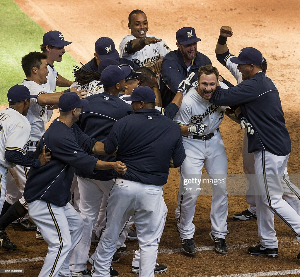 <a gi-track='captionPersonalityLinkClicked' href=/galleries/search?phrase=Jonathan+Lucroy&family=editorial&specificpeople=5732413 ng-click='$event.stopPropagation()'>Jonathan Lucroy</a> #20 of the Milwaukee Brewers is swarmed by his teammates after his sacrifice fly in the tenth inning wins the game on opening day at Miller Park on April 1, 2013 in Milwaukee, Wisconsin. Lucroy's sacrifice fly came off of Adam Ottavino #0 of the Colorado Rockies as the Milwaukee Brewers went on to defeat the Colorado Rockies 5-4.