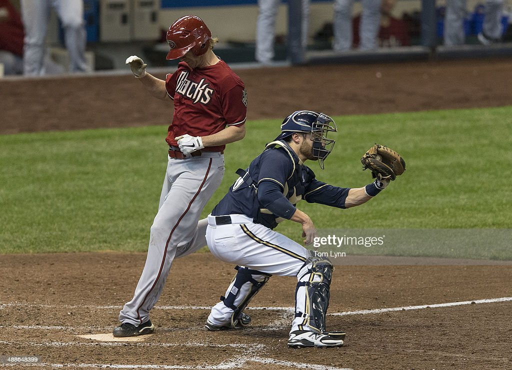 <a gi-track='captionPersonalityLinkClicked' href=/galleries/search?phrase=Jonathan+Lucroy&family=editorial&specificpeople=5732413 ng-click='$event.stopPropagation()'>Jonathan Lucroy</a> #20 of the Milwaukee Brewers makes the catch too late as <a gi-track='captionPersonalityLinkClicked' href=/galleries/search?phrase=Bronson+Arroyo&family=editorial&specificpeople=204136 ng-click='$event.stopPropagation()'>Bronson Arroyo</a> #61 of the Arizona Diamondbacks scores at Miller Park on May 7, 2014 in Milwaukee, Wisconsin.