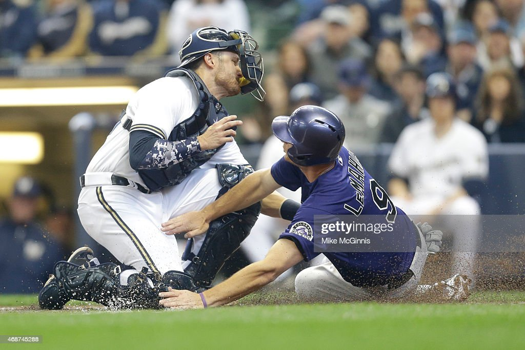 <a gi-track='captionPersonalityLinkClicked' href=/galleries/search?phrase=Jonathan+Lucroy&family=editorial&specificpeople=5732413 ng-click='$event.stopPropagation()'>Jonathan Lucroy</a> #20 of the Milwaukee Brewers makes the tag on D.J. LaMahieu #9 of the Colorado Rockies as he slides into home plate during the second inning during Opening Day at Miller Park on April 06, 2015 in Milwaukee, Wisconsin.