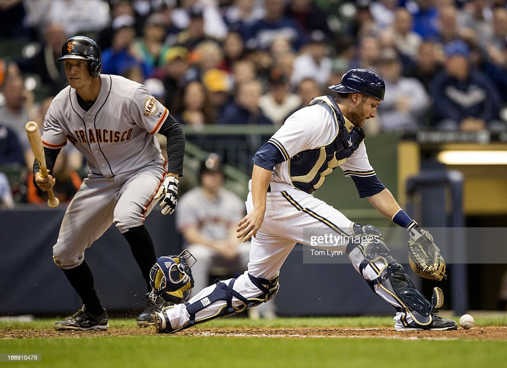 Jonathan Lucroy #20 of the Milwaukee Brewers picks up the ball and prepares to throw to first as Hunter Pence #8 of the San Francisco Giants strikes out swinging in the eighth inning at Miller Park on April 18, 2013 in Milwaukee, Wisconsin.