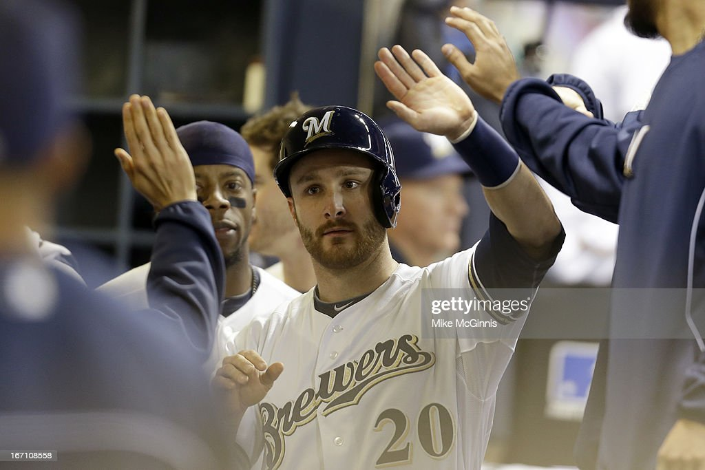 <a gi-track='captionPersonalityLinkClicked' href=/galleries/search?phrase=Jonathan+Lucroy&family=editorial&specificpeople=5732413 ng-click='$event.stopPropagation()'>Jonathan Lucroy</a> #20 of the Milwaukee Brewers reaches on a singles hit by Martin Maldonado in the bottom of the sixth inning against the Chicago Cubs at Miller Park on April 20, 2013 in Milwaukee, Wisconsin.