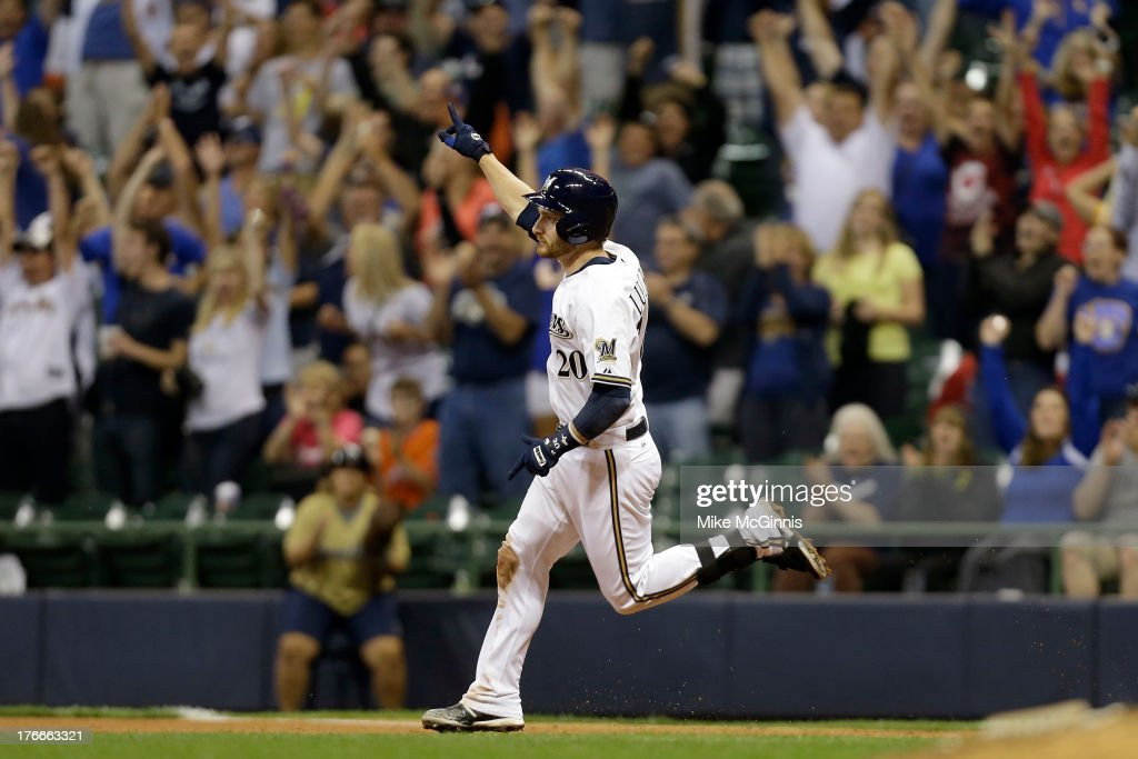<a gi-track='captionPersonalityLinkClicked' href=/galleries/search?phrase=Jonathan+Lucroy&family=editorial&specificpeople=5732413 ng-click='$event.stopPropagation()'>Jonathan Lucroy</a> #20 of the Milwaukee Brewers runs the bases after hitting a two-run, walk-off home run in the bottom of the ninth inning against the Cincinnati Reds at Miller Park on August 16, 2013 in Milwaukee, Wisconsin.