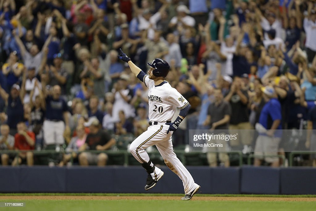 <a gi-track='captionPersonalityLinkClicked' href=/galleries/search?phrase=Jonathan+Lucroy&family=editorial&specificpeople=5732413 ng-click='$event.stopPropagation()'>Jonathan Lucroy</a> #20 of the Milwaukee Brewers runs the bases after hitting a two run walk off home run in the bottom of the ninth inning against the Cincinnati Reds at Miller Park on August 16, 2013 in Milwaukee, Wisconsin.