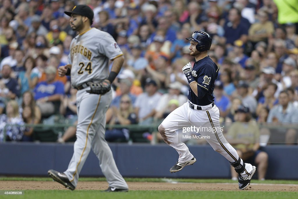 Jonathan Lucroy #20 of the Milwaukee Brewers runs the bases after hitting a double to left field during the fourth inning against the Pittsburgh Pirates at Miller Park on August 24, 2014 in Milwaukee, Wisconsin.