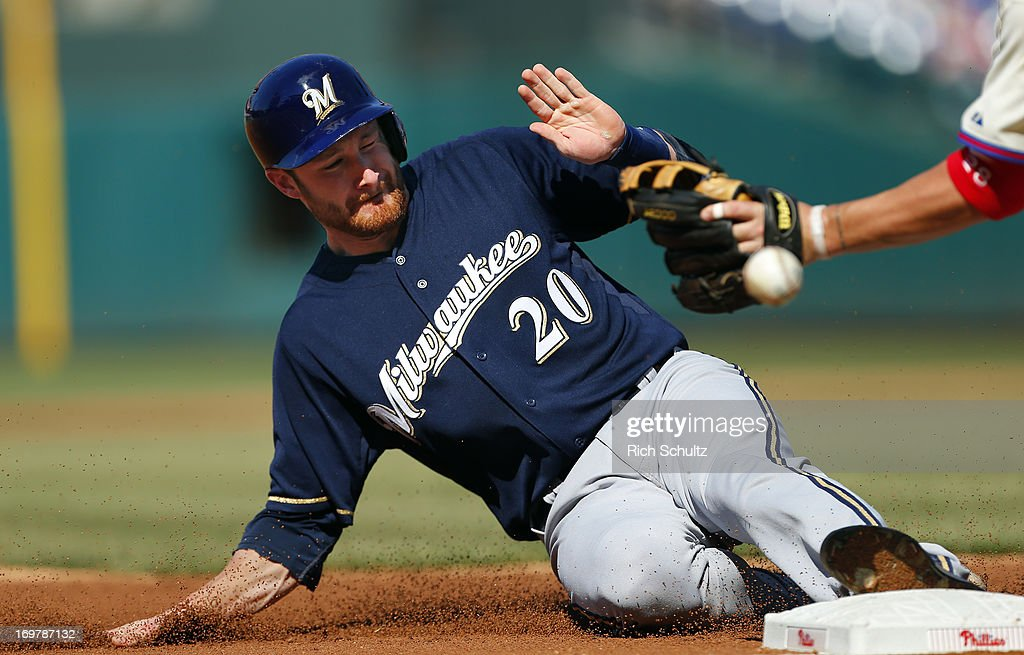 <a gi-track='captionPersonalityLinkClicked' href=/galleries/search?phrase=Jonathan+Lucroy&family=editorial&specificpeople=5732413 ng-click='$event.stopPropagation()'>Jonathan Lucroy</a> #20 of the Milwaukee Brewers slides safely into third base as the ball gets past third baseman <a gi-track='captionPersonalityLinkClicked' href=/galleries/search?phrase=Kevin+Frandsen&family=editorial&specificpeople=3982842 ng-click='$event.stopPropagation()'>Kevin Frandsen</a> #28 of the Philadelphia Phillies and would get up and score during the second inning in a MLB baseball game on June 1, 2013 at Citizens Bank Park in Philadelphia, Pennsylvania. The Brewers defeated the Phillies 4-3.