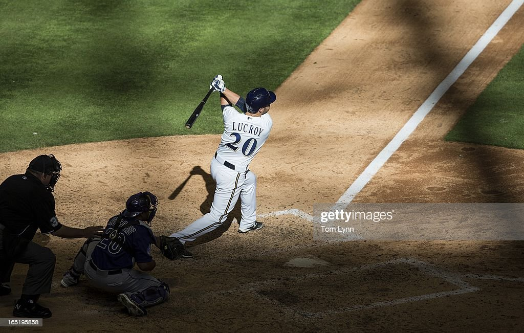 <a gi-track='captionPersonalityLinkClicked' href=/galleries/search?phrase=Jonathan+Lucroy&family=editorial&specificpeople=5732413 ng-click='$event.stopPropagation()'>Jonathan Lucroy</a> #20 of the Milwaukee Brewers watches his game winning sacrifice fly off of Adam Ottavino #0 of the Colorado Rockies in the tenth inning that scored Rickie Weeks #23 of the Brewers on opening day at Miller Park on April 1, 2013 in Milwaukee, Wisconsin. The Milwaukee Brewers defeated the Colorado Rockies 5-4.