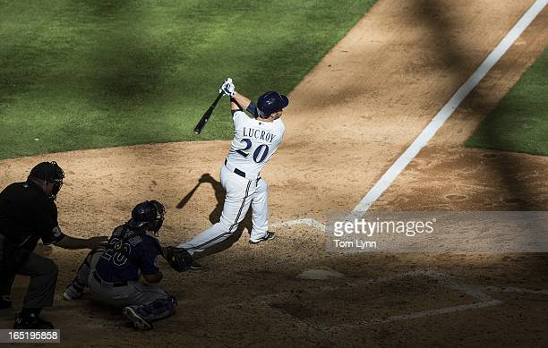Jonathan Lucroy of the Milwaukee Brewers watches his game winning sacrifice fly off of Adam Ottavino of the Colorado Rockies in the tenth inning that...