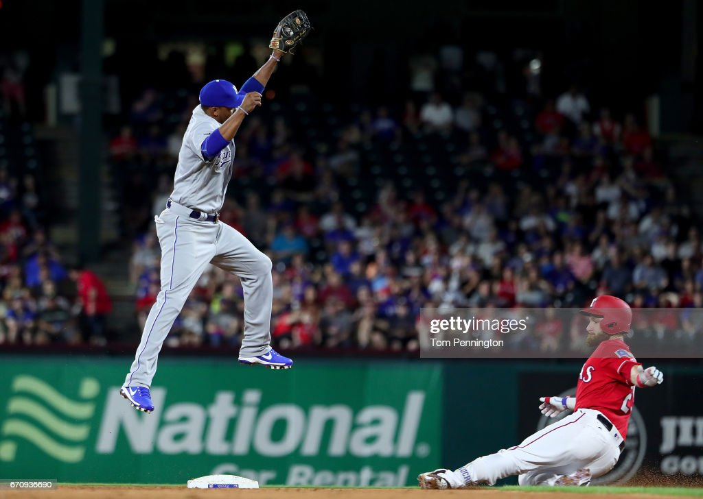 Jonathan Lucroy #25 of the Texas Rangers slides into second base against Alcides Escobar #2 of the Kansas City Royals in the bottom of the fifth inning at Globe Life Park in Arlington on April 20, 2017 in Arlington, Texas.