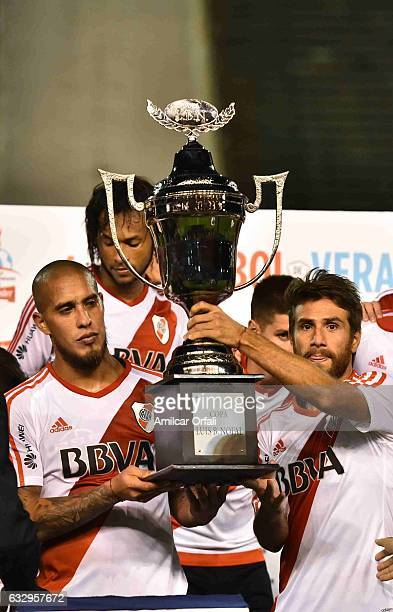 Jonathan Maidana and Leonardo Ponzio of River Plate lift the trophy after a match between Boca Juniors and River Plate as part of the Torneo de...