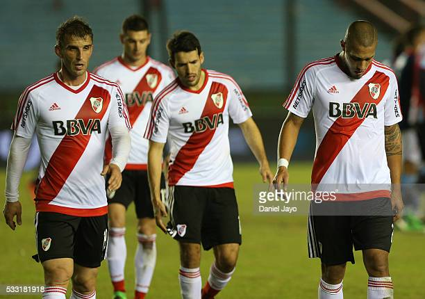 Jonathan Maidana of River Plate and his teammates leave the field at the end of the first half during a match between Arsenal FC and River Plate as...
