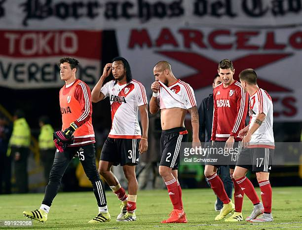 Jonathan Maidana of River Plate and his teammates react at the end of the first leg match between Santa Fe and River Plate as part of Recopa...
