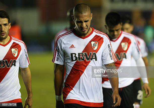 Jonathan Maidana of River Plate and teammates leave the field at the end of the first half during a match between Arsenal FC and River Plate as part...