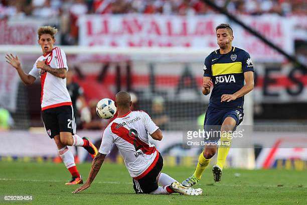 Jonathan Maidana of River Plate challenges Rodrigo Bentancur of Boca Juniors during the Argentine Primera Division match between River Plate and Boca...