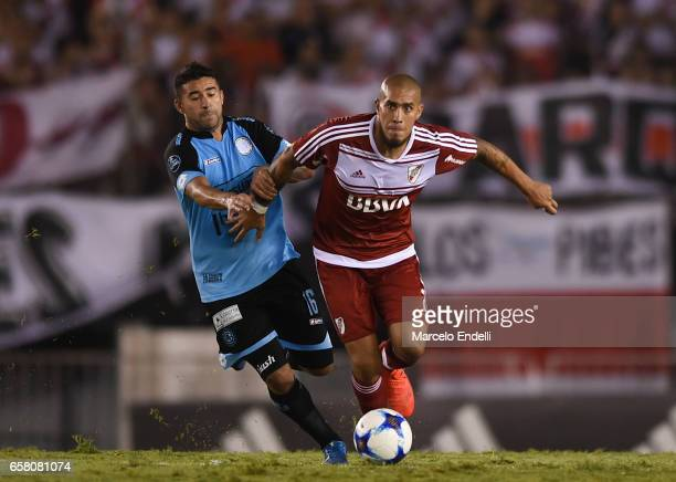 Jonathan Maidana of River Plate fights for ball with Claudio Bieber of Belgrano during a match between River Plate and Belgrano as part of Torneo...