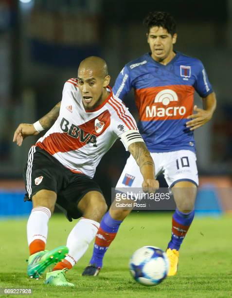 Jonathan Maidana of River Plate fights for the ball with Diego Morales of Tigre during a match between Tigre and River Plate as part of Torneo...