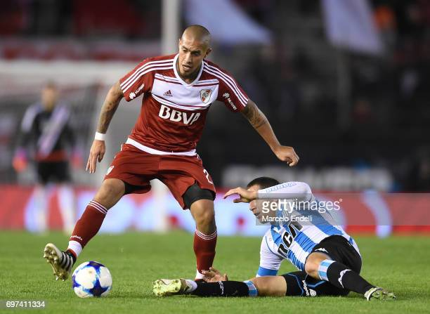 Jonathan Maidana of River Plate fights for the ball with Luciano Aued of Racing Club Club during a match between River Plate and Racing Club as part...