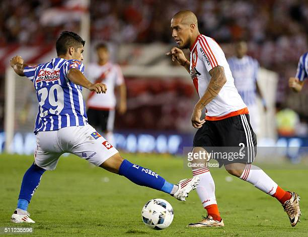 Jonathan Maidana of River Plate fights for the ball with Luciano Abecasis of Godoy Cruz during a match between River Plate and Godoy Cruz as part of...