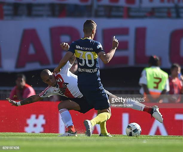 Jonathan Maidana of River Plate fights for the ball with Rodrigo Bentancur of Boca Juniors during a match between River Plate and Boca Juniors as...