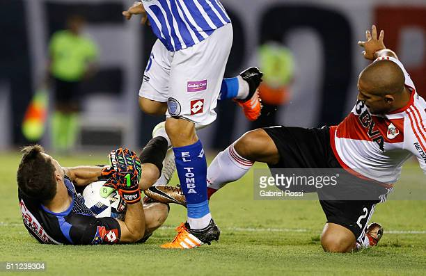 Jonathan Maidana of River Plate fights for the ball with Rodrigo Rey of Godoy Cruz during a match between River Plate and Godoy Cruz as part of third...
