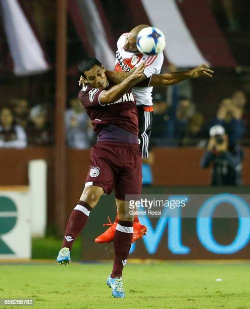 Jonathan Maidana of River Plate heads the ball over Jose Sand of Lanus during a match between Lanus and River Plate as part of Torneo Primera...