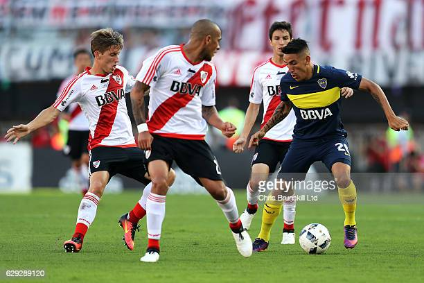 Jonathan Maidana of River Plate in action with Ricardo Centurion of Boca Juniors during the Argentine Primera Division match between River Plate and...