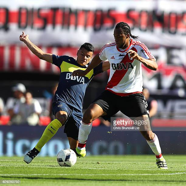 Jonathan Maidana of River Plate in action with Walter Bou of Boca Juniors during the Argentine Primera Division match between River Plate and Boca...