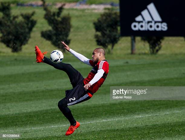 Jonathan Maidana of River Plate kicks the ball during a training session at River Plate's training camp on September 09 2016 in Ezeiza Argentina