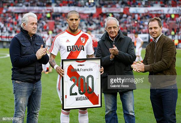 Jonathan Maidana of River Plate receives a commemorative jersey for his 200 hundred matches with River Plate from Rodolfo D'Onofrio President of...