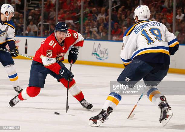 Jonathan Marchessault of the Florida Panthers skates with the puck against Jay Bouwmeester of the St Louis Blues at the BBT Center on April 6 2017 in...